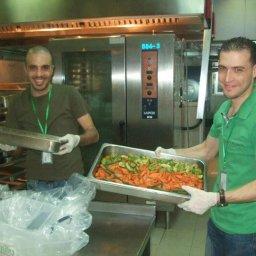 Volunteers collecting food during Ramadan