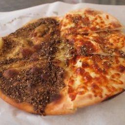 mankouche cheese and zaatar .