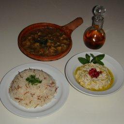سمك بالليمون و الثوم بالفخارة مع صحن متبل fish with lemon & garlic in a pottery dish with a side plate of mutabbal (minced eggplant in a tahibi sauce)