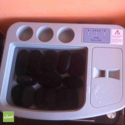 جهاز المساج الحصى الحار     Massage hot stone treatment